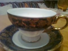 Beautiful tea Cup and saucer with gold patterns.New